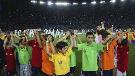 TBILISI, GEORGIA - AUGUST 11:  Children lift the arms during the pre-match entertainment during the UEFA Super Cup between Barcelona and Sevilla FC at Dinamo Arena on August 11, 2015 in Tbilisi, Georgia.  (Photo by Chris Brunskill/Getty Images)