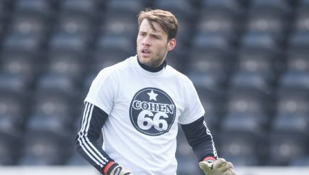 Goalkeeper Marcus Bettinelli of Fulham warming up before the SkyBet Championship match between Fulham and Bristol City played at Craven Cottage Stadium, London on March 12th 2016 -------------------- Ben Queenborough / BPI Sky Bet Championship 2015/16 Fulham v Bristol City - Commercial & Marketing  12 March 2016 ©2016 Ben Queenborough / BPI all rights reserved
